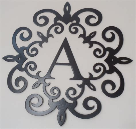 Family Initial Monogram Inside A Metal Scroll With A Metal Wall Decor Letters