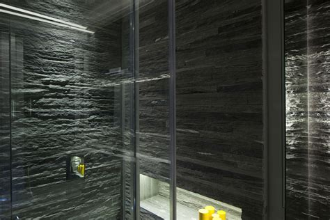 stone wall bathroom bathroom lighting stone tiles glass walls elegant apartment with reflective