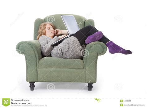 woman in armchair young woman in armchair with laptop stock image image