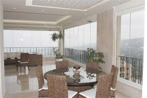 chiudere terrazzo per ricavare stanza vetrate