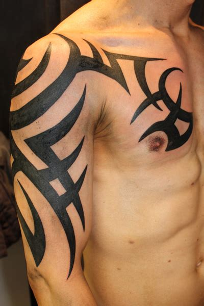 tribal chest and arm tattoos black ink tribal on right half sleeve and chest
