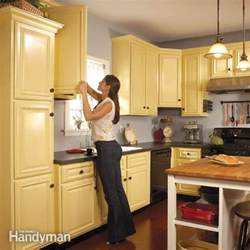 How To Paint Old Kitchen Cabinets instead of replacing your old kitchen cabinets make them new by