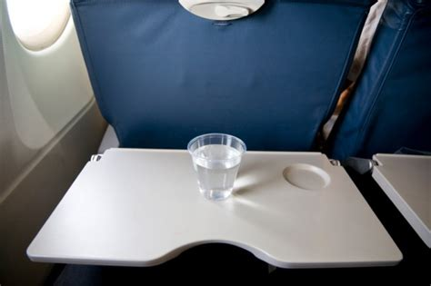Airplane Tray Table by How To Avoid Getting A Cold On A Plane Chatelaine