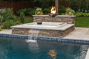 how to build a waterfall into a pool inground partially recessed portable hot tub with fire