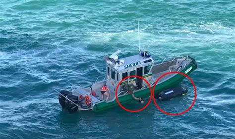 jet ski hits boat jet skiers pulled to safety seconds before being hit by