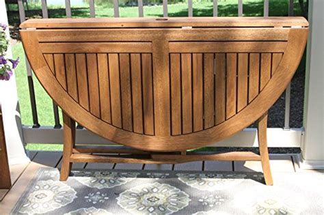 outdoor interiors tna2000 20 in round teak outdoor accent outdoor interiors round folding table 48 inch brown