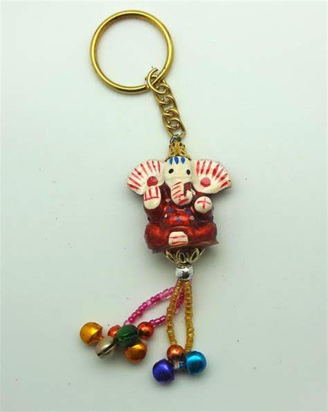 happy ganesh key ring with beaded tassel and bells