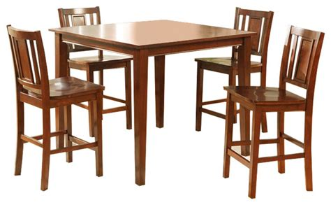 medium oak 5 counter height dining table and chairs