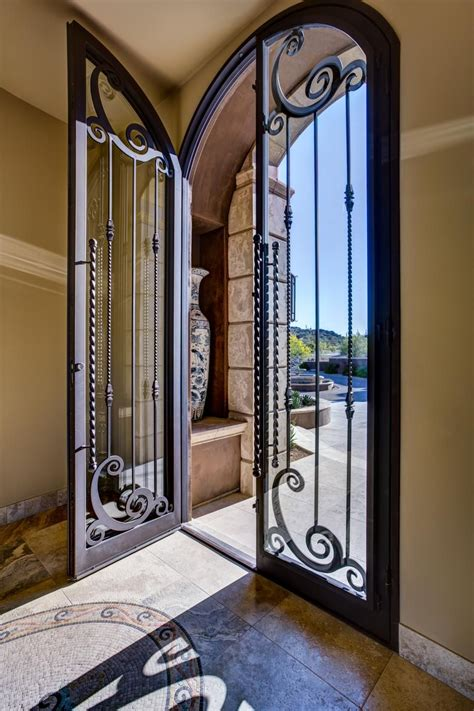 home entryway  tall glass  wrought iron door