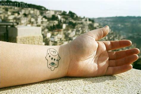 25 striking hamsa tattoo designs 17 best ideas about hamsa design on