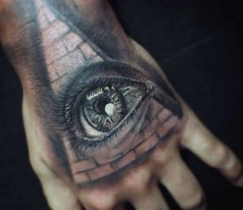 black and grey eye tattoo black and grey eye with pyramid tattoo on hand