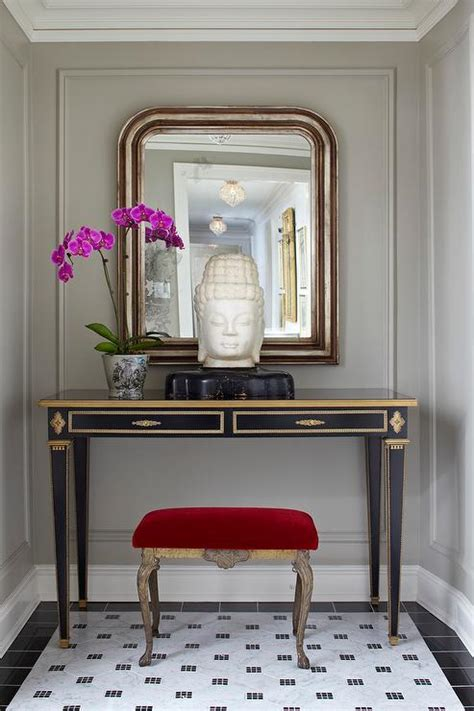 red velvet stool tucked   black  gold console table