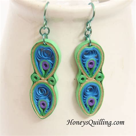 how to do earrings from peacock design paper quilled earrings tutorial honey s