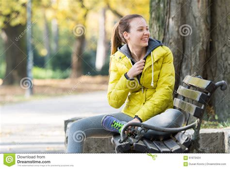 sitting on a park bench girl sitting on a park bench stock photo image 61973424