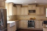staggered height wall cabinets were used to create an