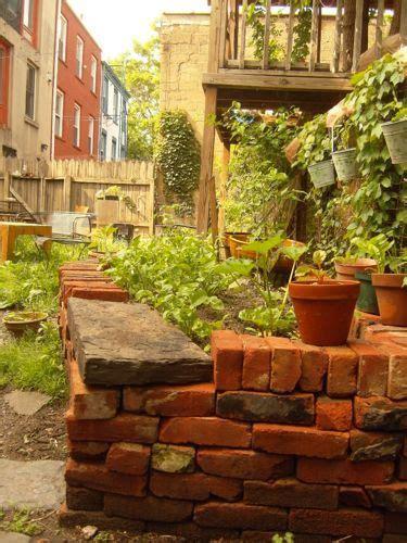 salvaged bricks stacked dry  mortar