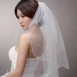 black wedding hairstyle with white veil