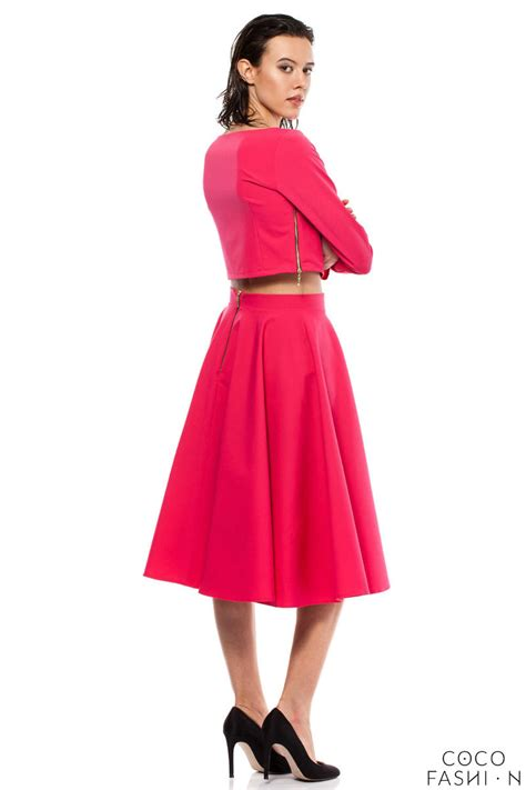 pink pleated midi skirt with back zipper fastening