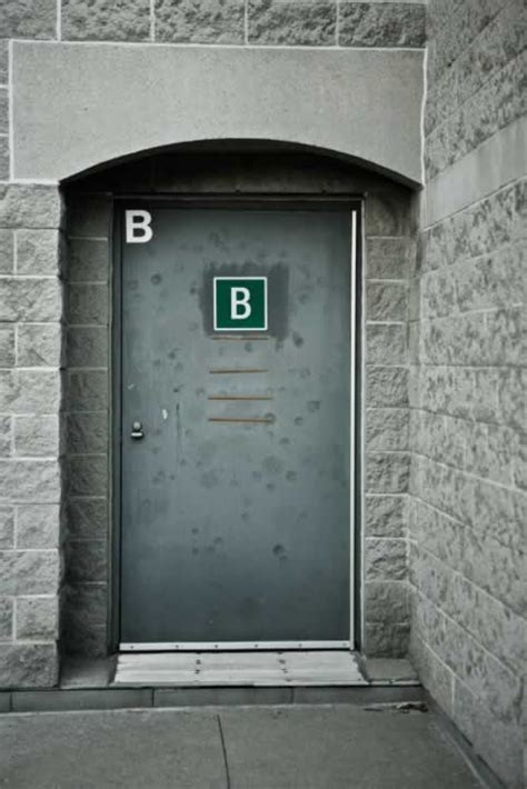 Exterior Metal Door Gray Metal Exterior Door Marked With The Letter B Door And Window