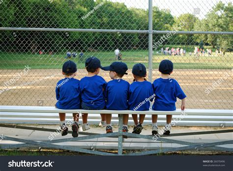 bench ball games five little boys sit on a bench and wait for their