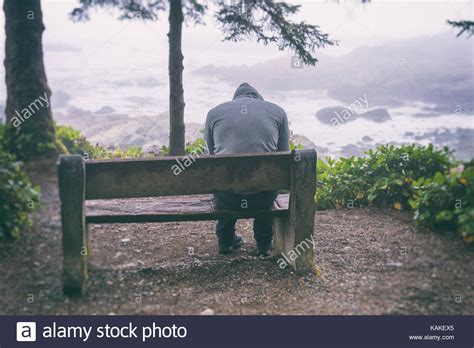 lonely man on bench sad man sits on bench stock photos sad man sits on bench