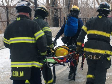 minneapolis rescue mpls firefighters rescue motorist after car plunges river bank minnesota