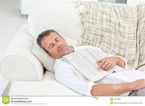 sleeping on a couch exhausted man sleeping on the couch royalty free stock