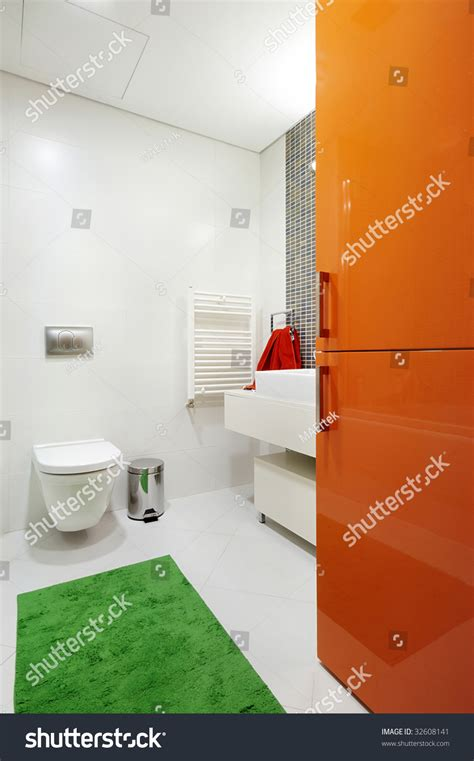 red and green bathroom modern mostly white bathroom colorful orange stock photo