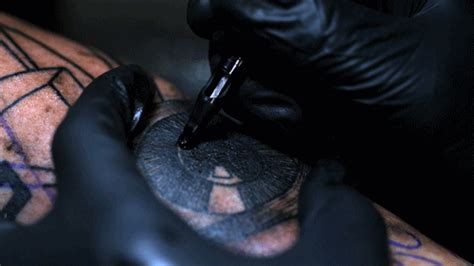 slow motion tattoo an motion of a artist working
