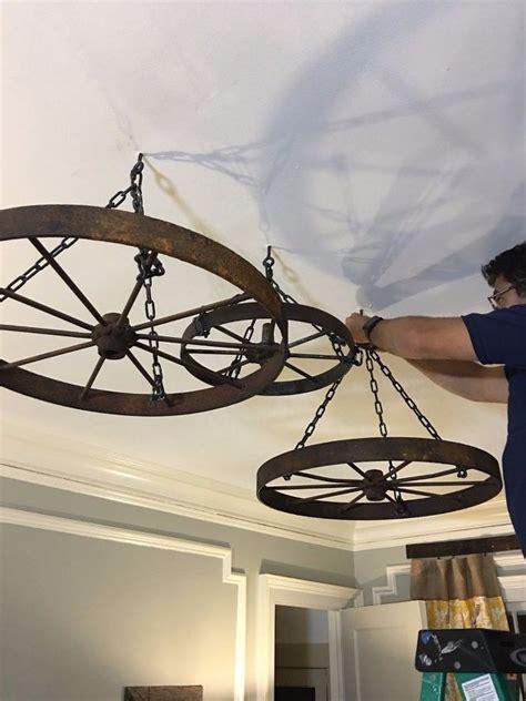 wagon wheel chandelier diy 25 best ideas about wheel chandelier on wagon