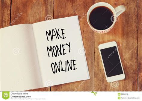 Make Money Online With Smartphone - top view image of open note book with the phrase make money online next to cup of