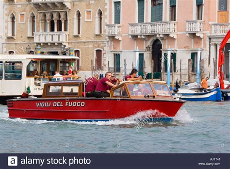 fire boat venice firemen riding in fire department boat on the grand canal