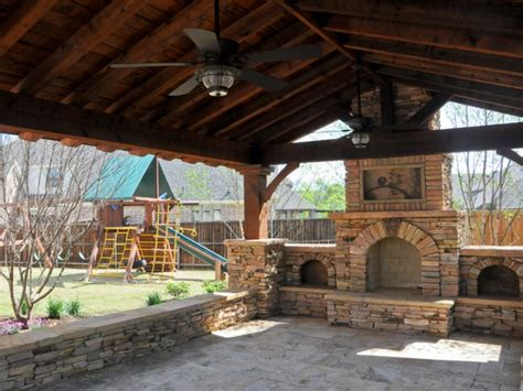 Stone outdoor grill, covered porch with fireplace patio