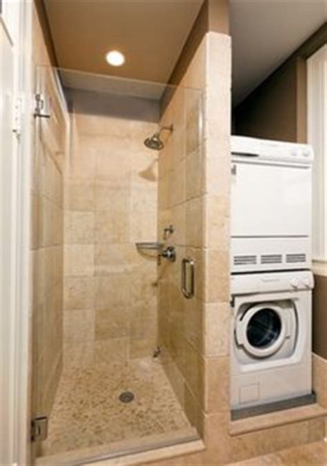 stacked washer  dryer  small shower  bathroom