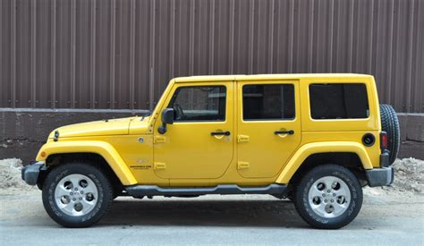 yellow jeep 4 door image gallery jeep sahara