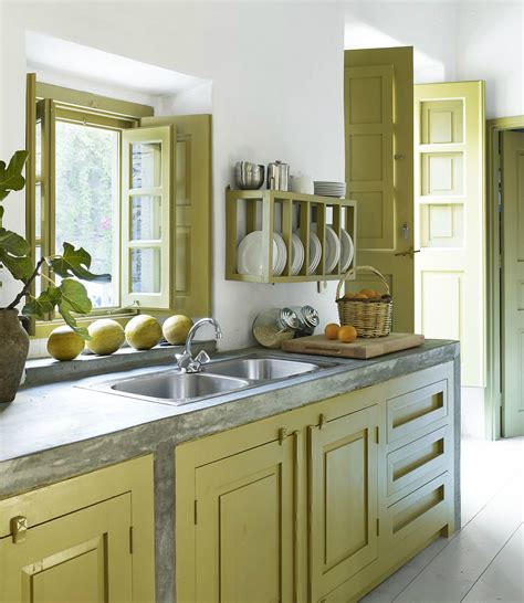 elle decor predicts the color trends for yellow kitchen interior cabinets benjamin moore guilford green and other colours are