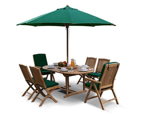 deluxe brompton teak extendable dining table and 6 chairs