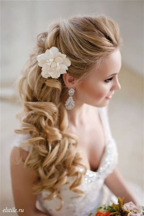 white wedding hairstyles half up half down wavy bridal hairstyle with white flower