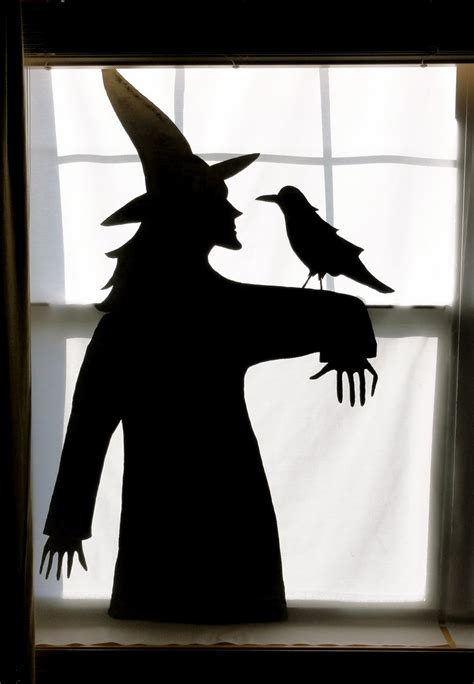 birshykat witch with caldron window silhouette