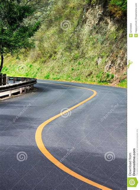 curved road with trees on both sides stock photo colourbox road curve stock photo image 52134959