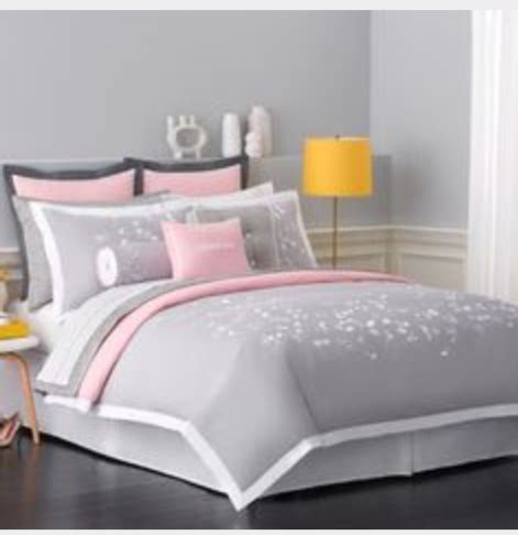 grey light pink and white double bedding on the hunt