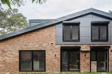 renovating a 1970s house nestled on nature s edge 1970s brick dwelling gets a modern upgrade