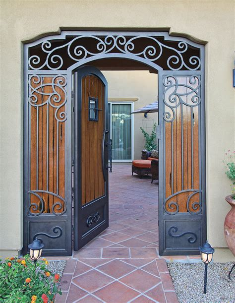 custom swirl iron and wood gate by impression