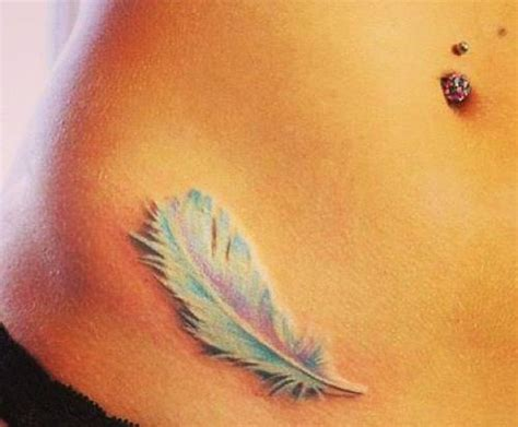 feather tattoo racist belly button ring featger hip tattoo we heart it