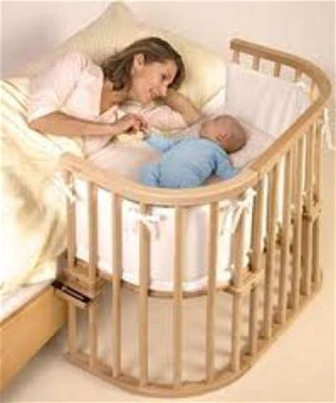 baby sleeps on side in crib putting baby to sleep of