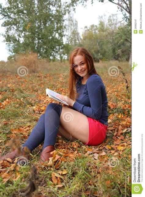 shameless preteens legs open young beautiful girl holding an open book read stock