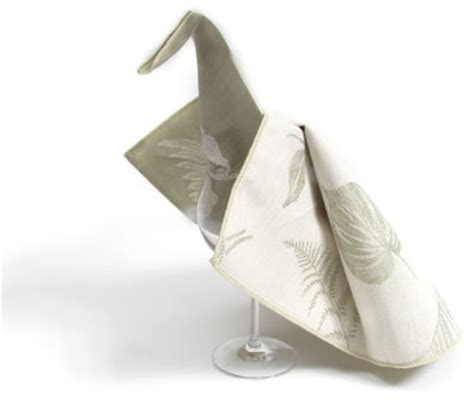 Folding Paper Napkins In Glasses - peacock napkin