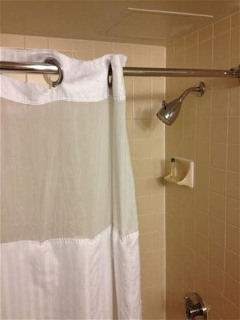 hilton hotel shower curtain older shower and ripped curtain picture of doubletree