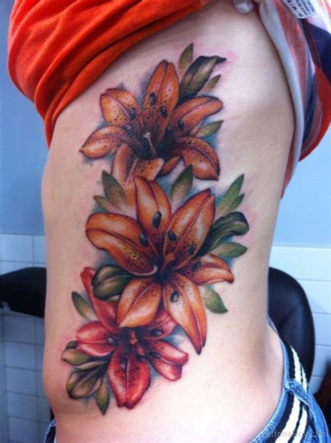 colored flower tattoos 30 flowers tattoos on side rib