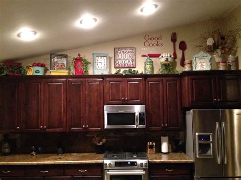 kitchen cabinets decor how to decorate on top of cabinets with vaulted ceiling